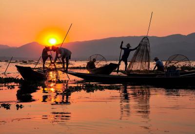 Fishermen at sunset in Myanmar